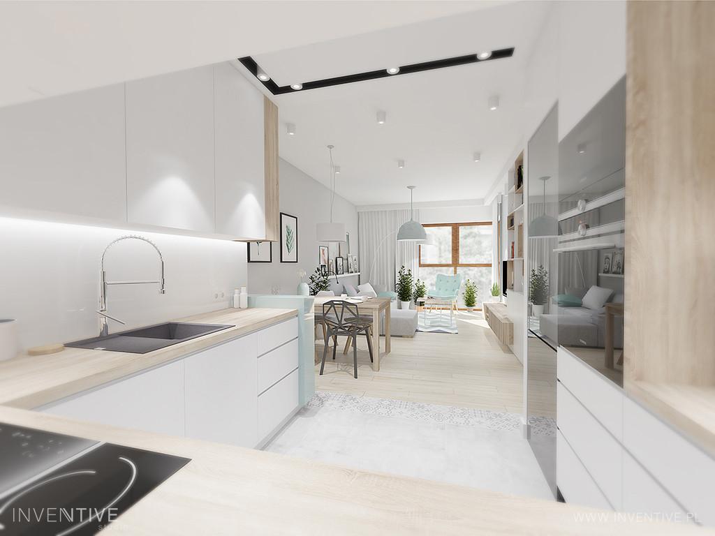 Aranżacja kuchni w bieli z szarym zlewem prostokątnym