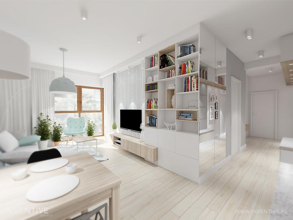 Aranżacja salonu z białymi meblami i pastelowym fotelem