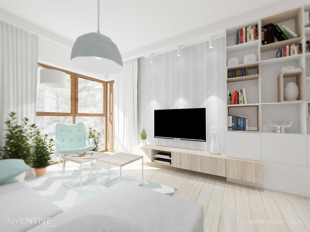 Aranżacja salonu z fotelem w pastelowym kolorze