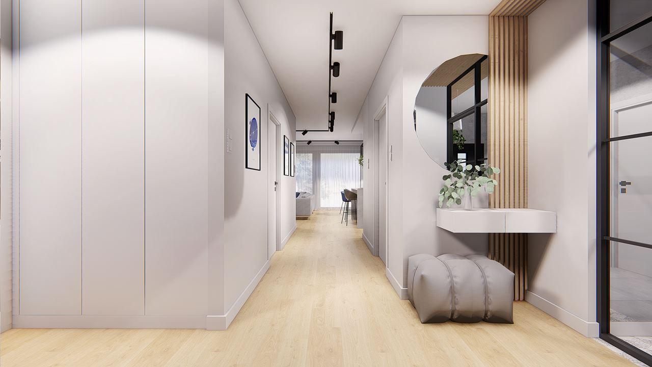 Przedpokój z jasną podłogą i elementami drewna na ścianie
