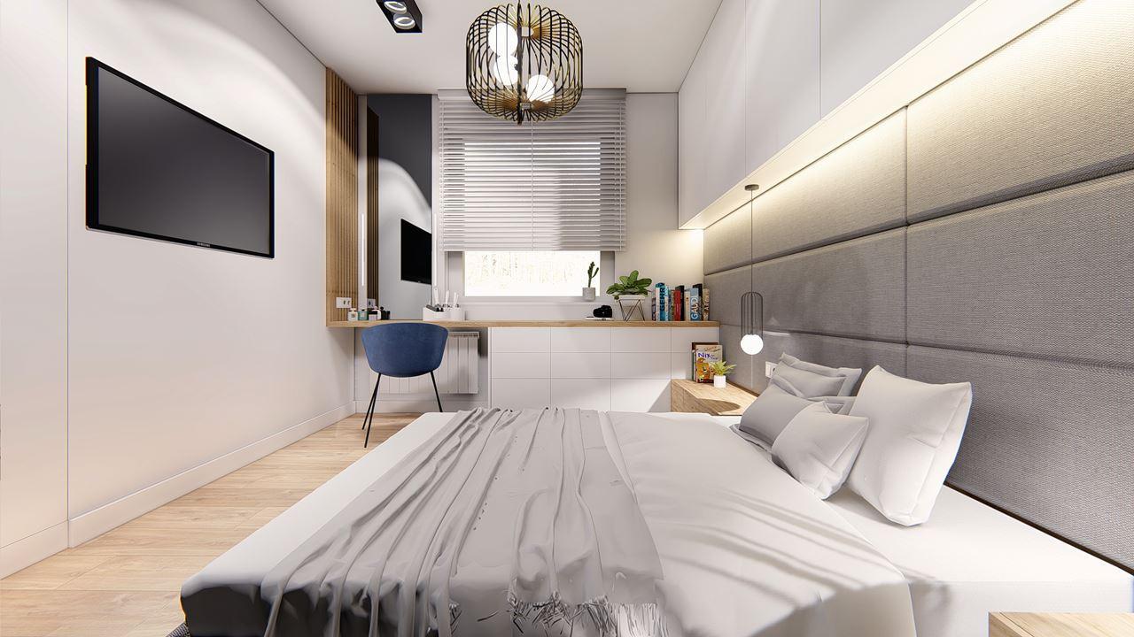 Sypialnia z telewizorem na ścianie, z biurkiem przy oknie