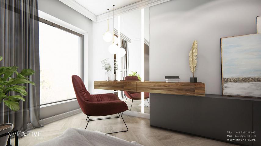 Nowoczesna sypialnia z dużym oknem i drewnianym biurkiem