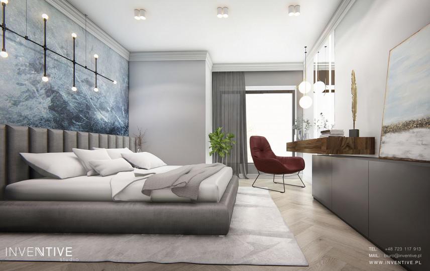 Sypialnia z tapetą w kolorze nieba i z łóżkiem kontynentalnym