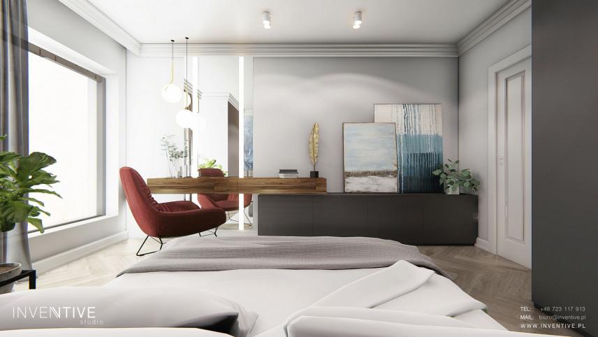 Nowoczesna, słoneczna sypialnia z łóżkiem kontynentalnym