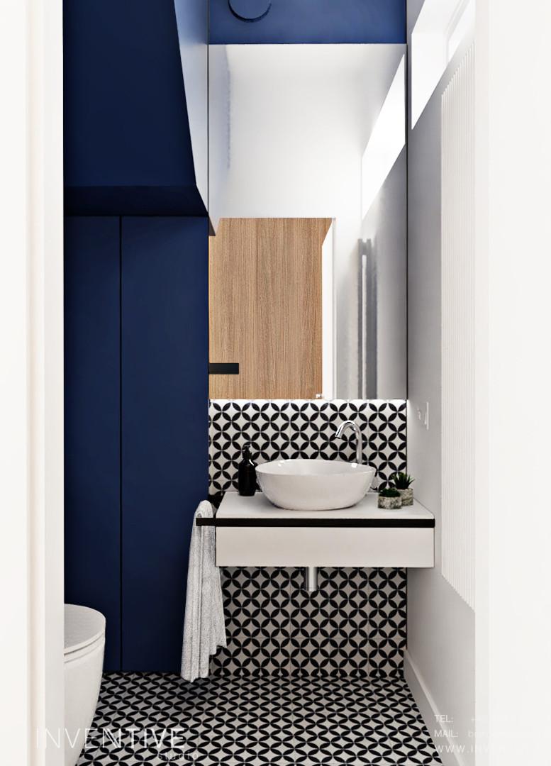 Łazienka z granowymi ścianami i biało-czarnymi płytkami