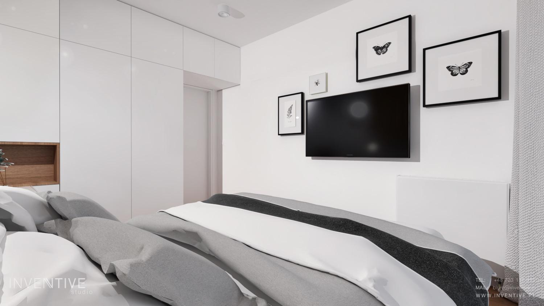 Jasna sypialnia z telewizorem na ścianie
