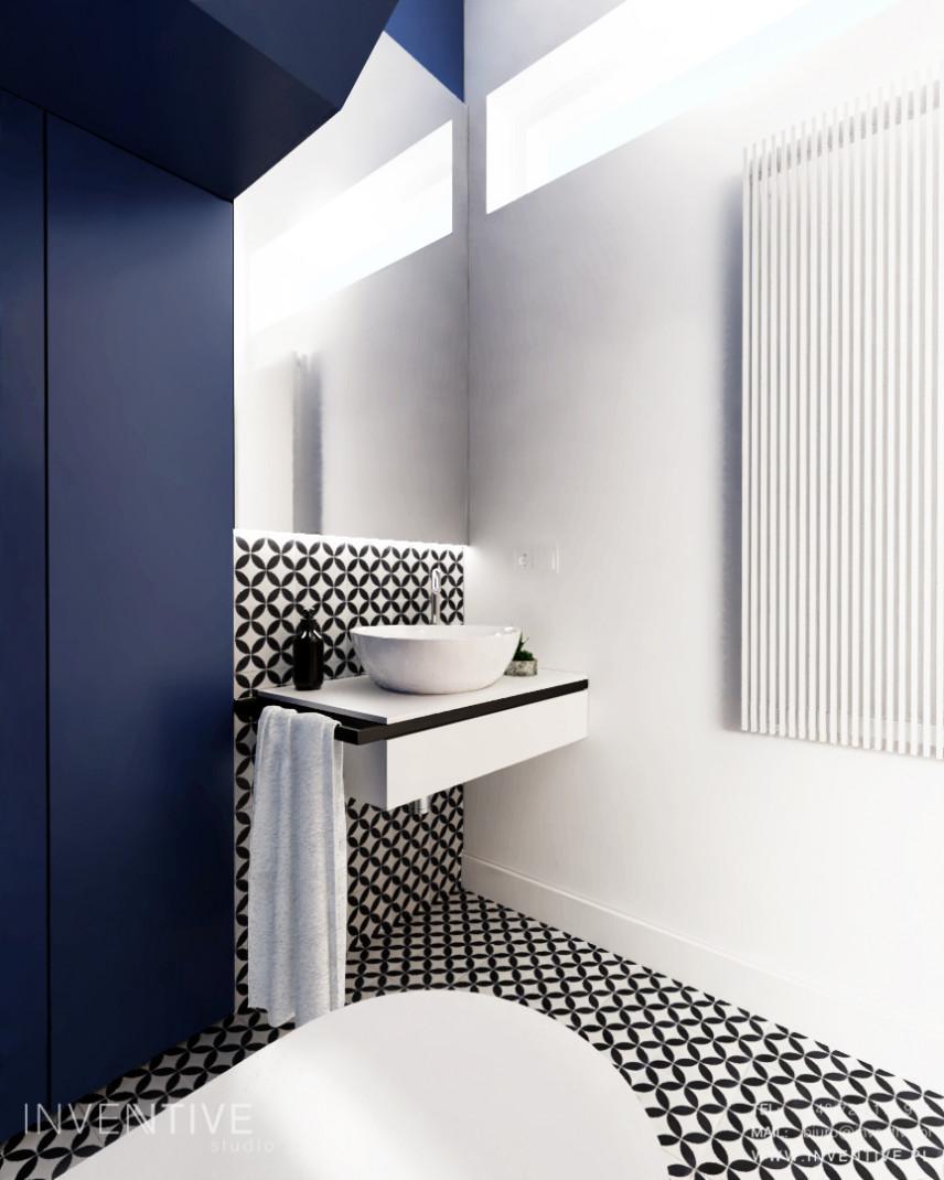 Biało-granatowa łazienka z białym zlewem nablatowym