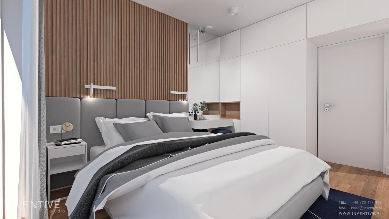 Sypialnia z drewniano-tapicerowaną ścianą