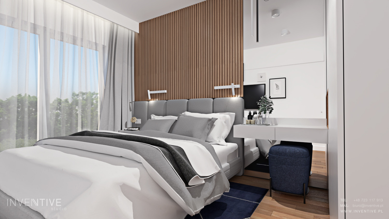 Sypialnia z elementem drewnianym na ścianie z łóżkiem kontynentalnym