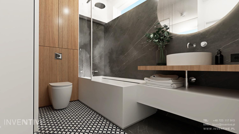 Łazienka z szarymi gresowymi płytkami na ścianie