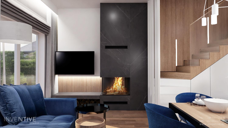 Salon z kominkiem i telewizorem na ścianie