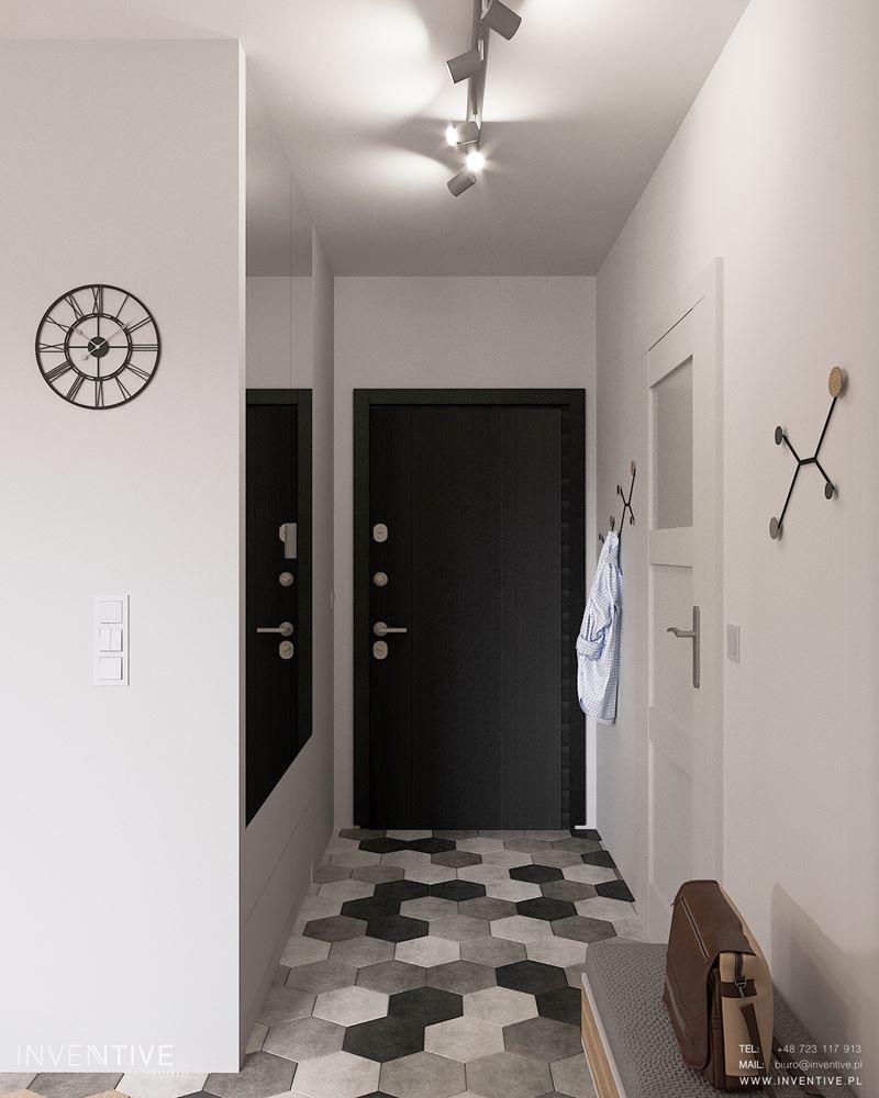 Przedpokój z szarymi płytkami we wzorze heksagonalnym na podłodze