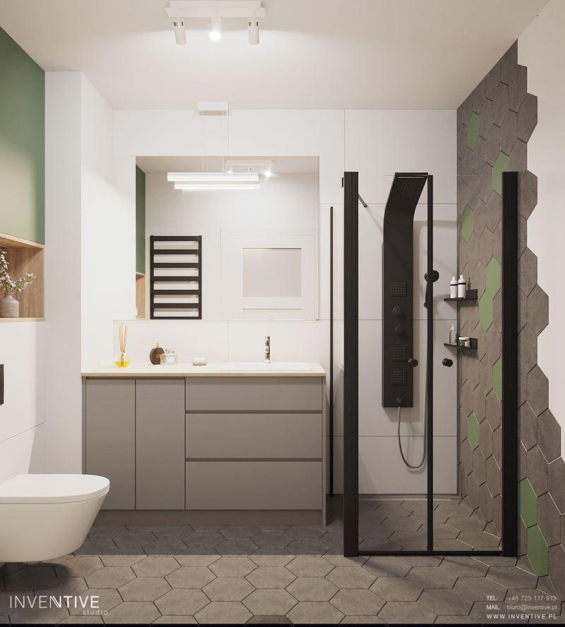 Łazienka z płytkami we wzorze heksagonalnym na podłodze i ścianie