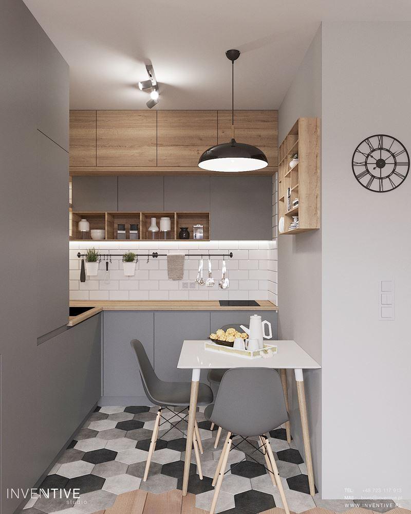 Kuchnia z szarymi ścianami i szarymi meblami