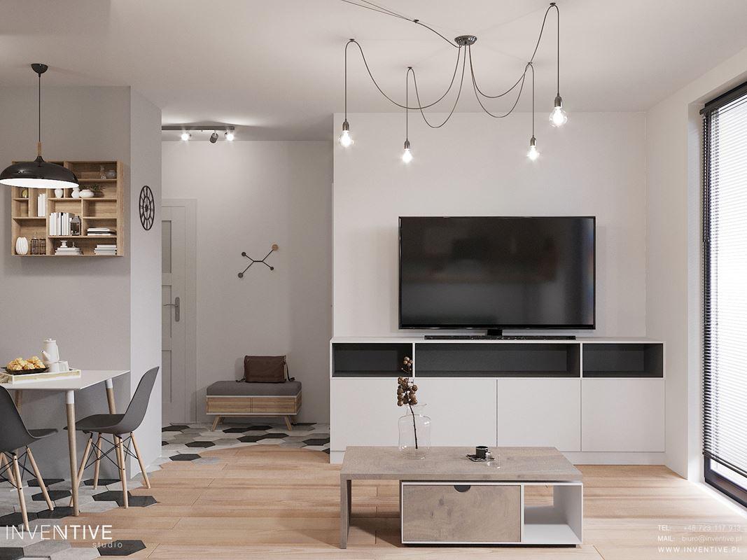 Salon z jadalnią i modnym oświetleniem z telewizorem na ścianie