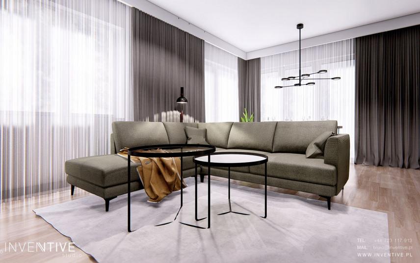 Salon z sofa w kolorze butelkowej zieleni