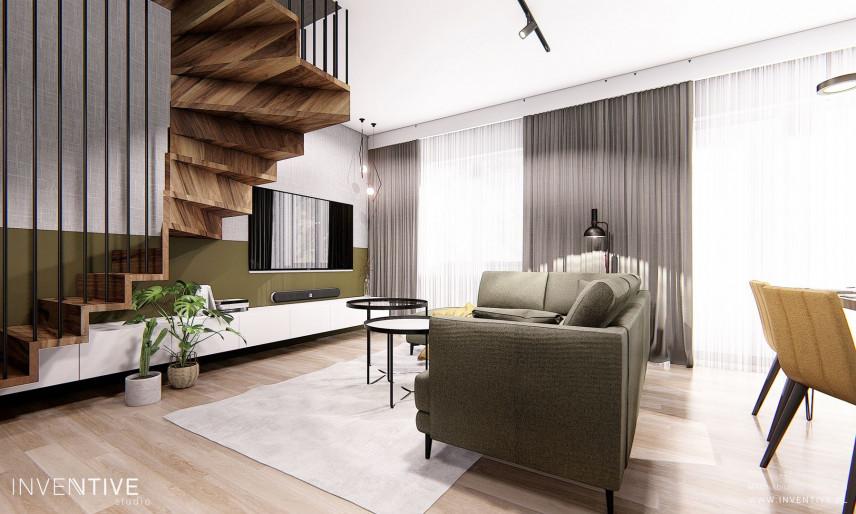 Aranżacja salonu z drewnianymi, okrągłymi schodami