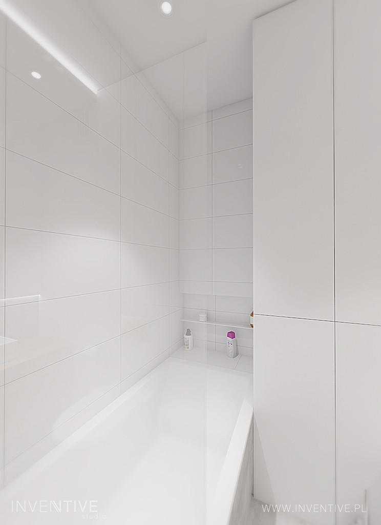 Minimalna łazienka z białymi płytkami