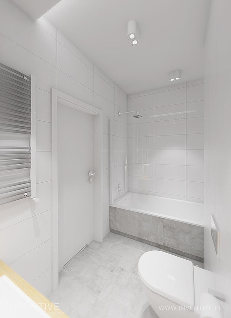 Łazienka z białymi poziomymi płytkami