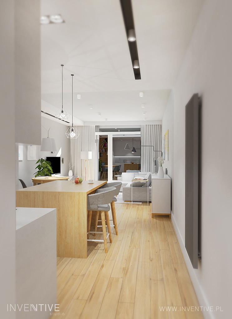 Drewniana wyspa w kuchni z wysokimi krzesłami