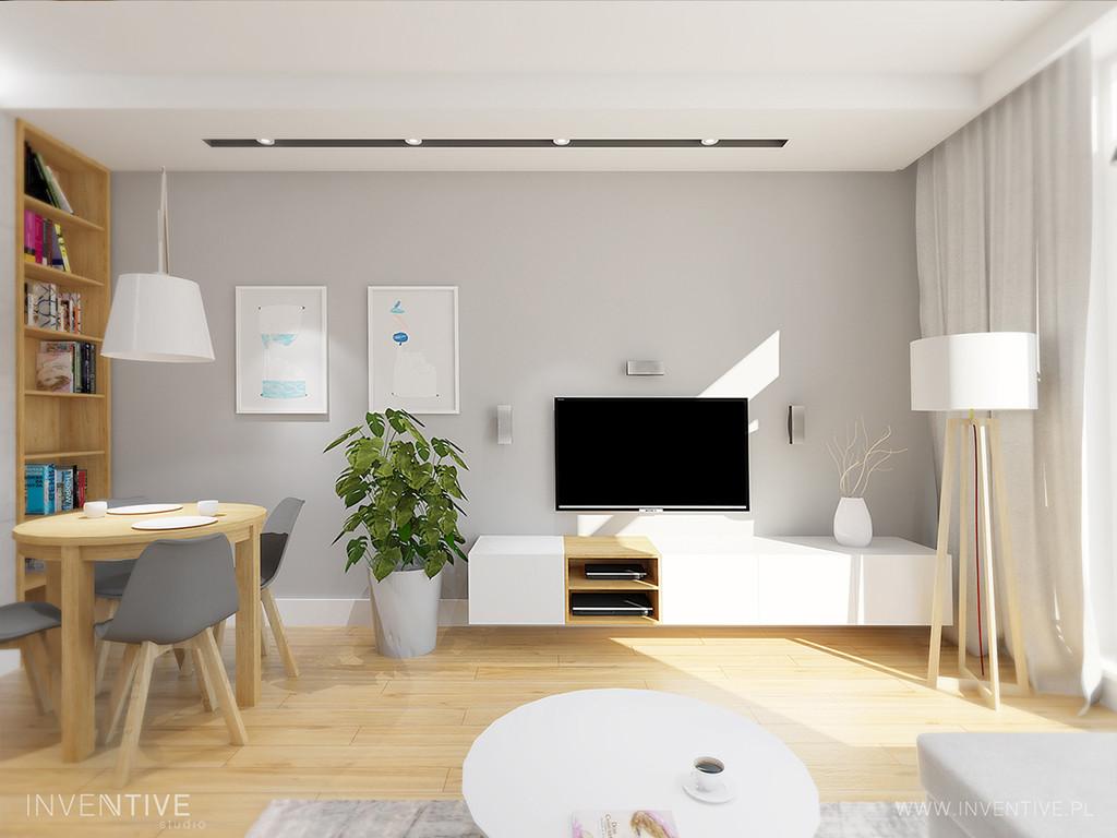 Projekt salonu z białą niską komodą