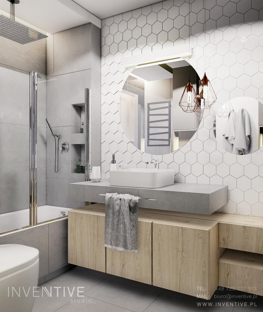 Łazianka z białymi płytkami ze wzorem heksagonalnym