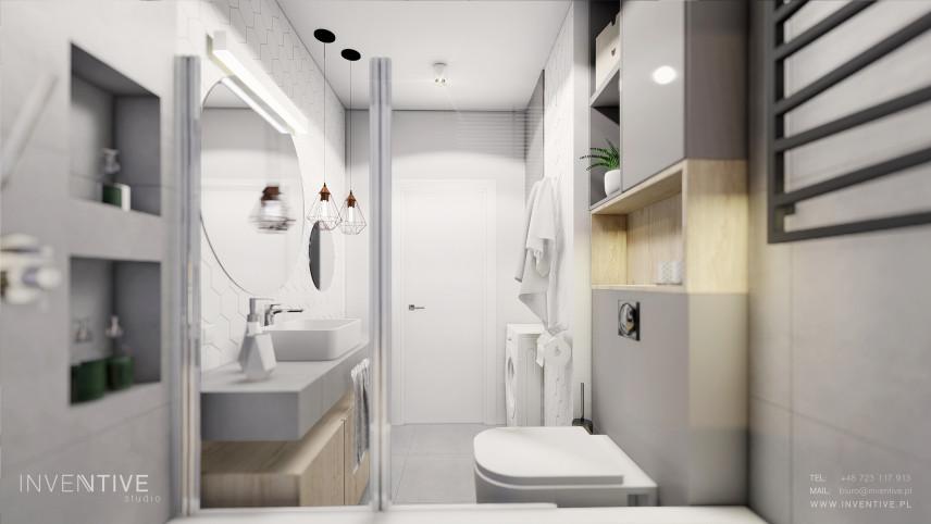 Łazienka z okrągłym lustrem i białym blatem wiszącym