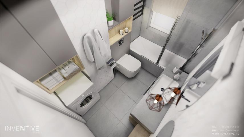 Rzut z góry na łazienkę z szarymi płytkami