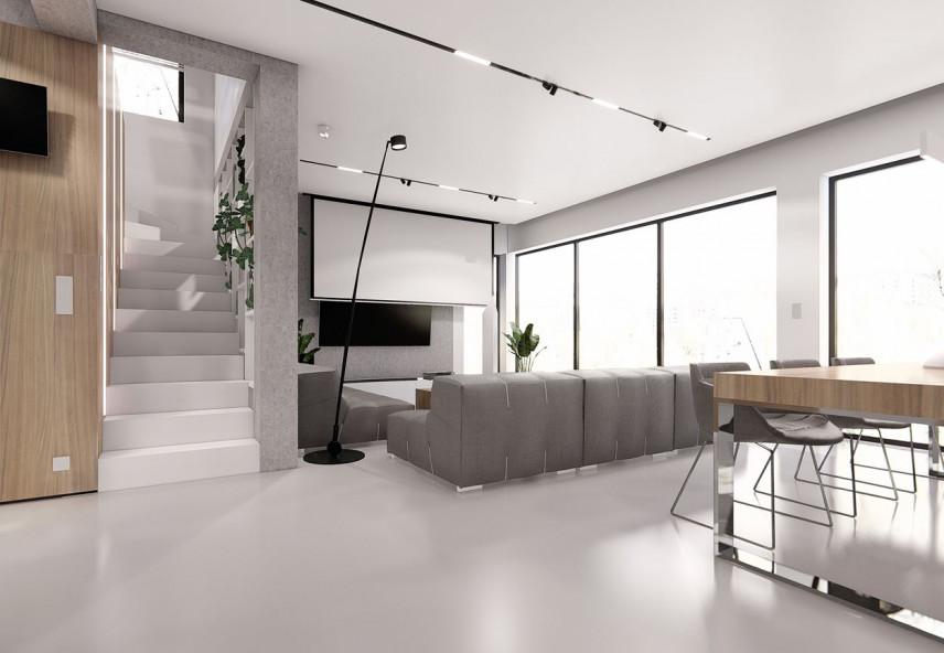 Projekt kuchni i salonu ze schodami prowadzącymi na piętro