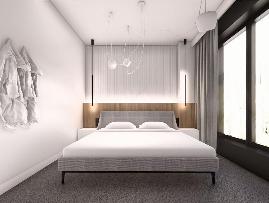 Projekt sypialni z łóżkiem kontynentalnym i z szarą wykładziną