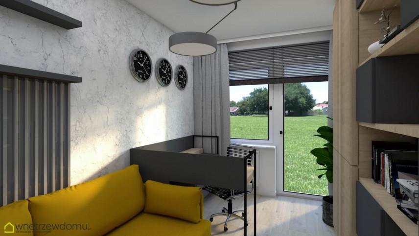 Biuro w domu z szarym biurkiem zabudowanym