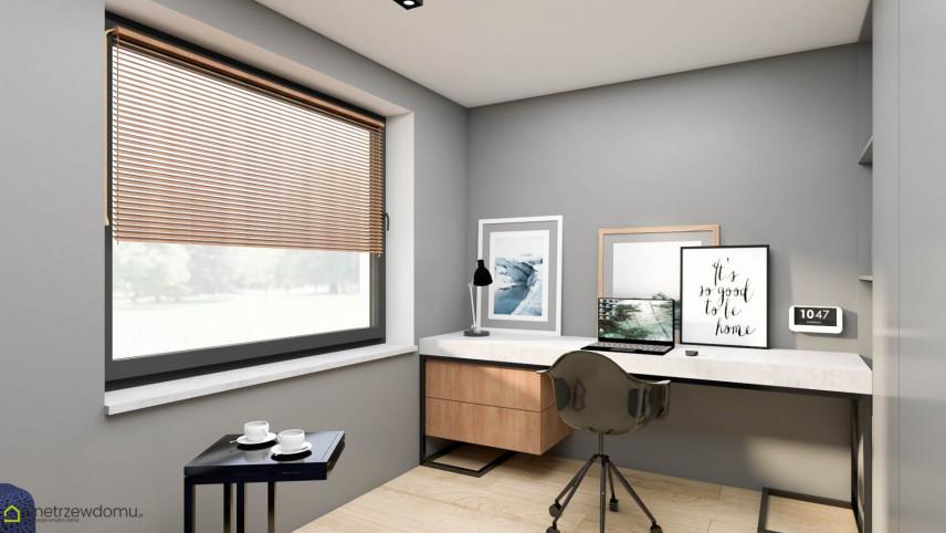 Biuro w domu z dużym oknem