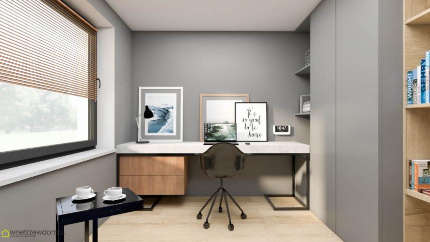 Aranżacja biura w domu z dużym oknem
