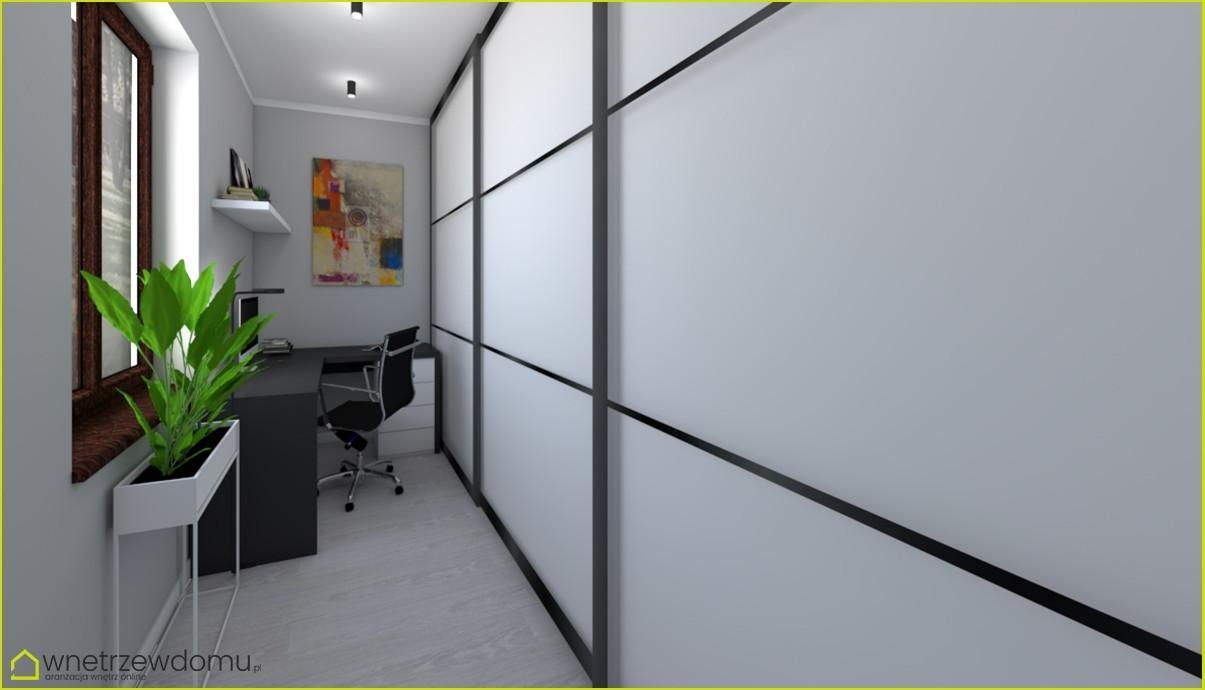 biuro w domu z czarnym biurkiem