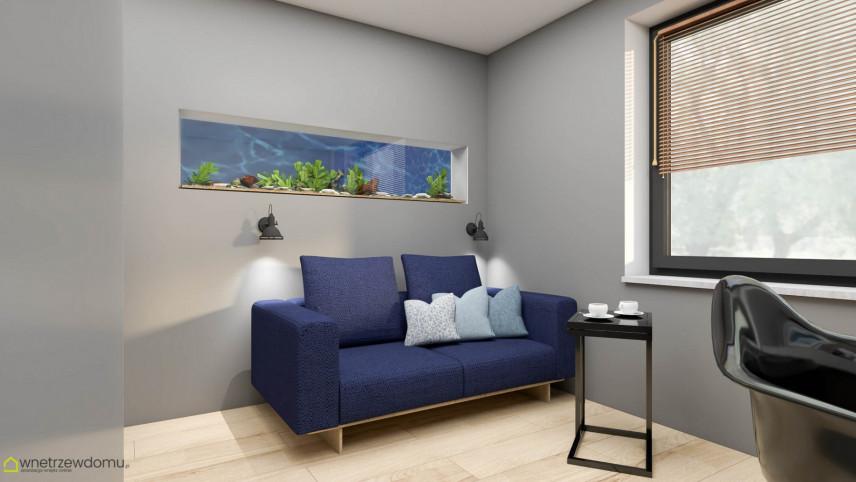 Biuro w domu z akwarium w ścianie