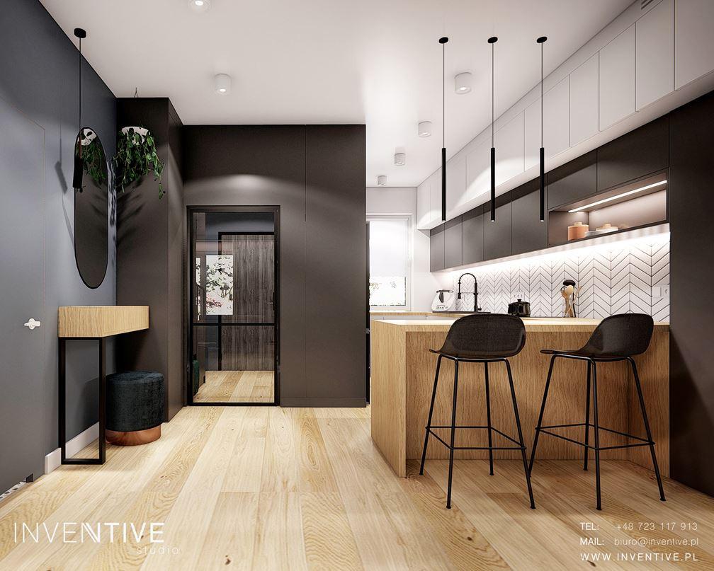 Aranżacja korytarza z otwartym wejściem do kuchni