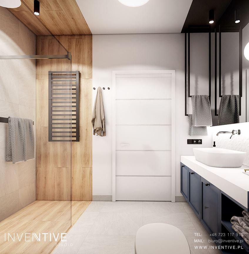 Łazienka z imitacją drewnianych płytek na ścianie i podłodze