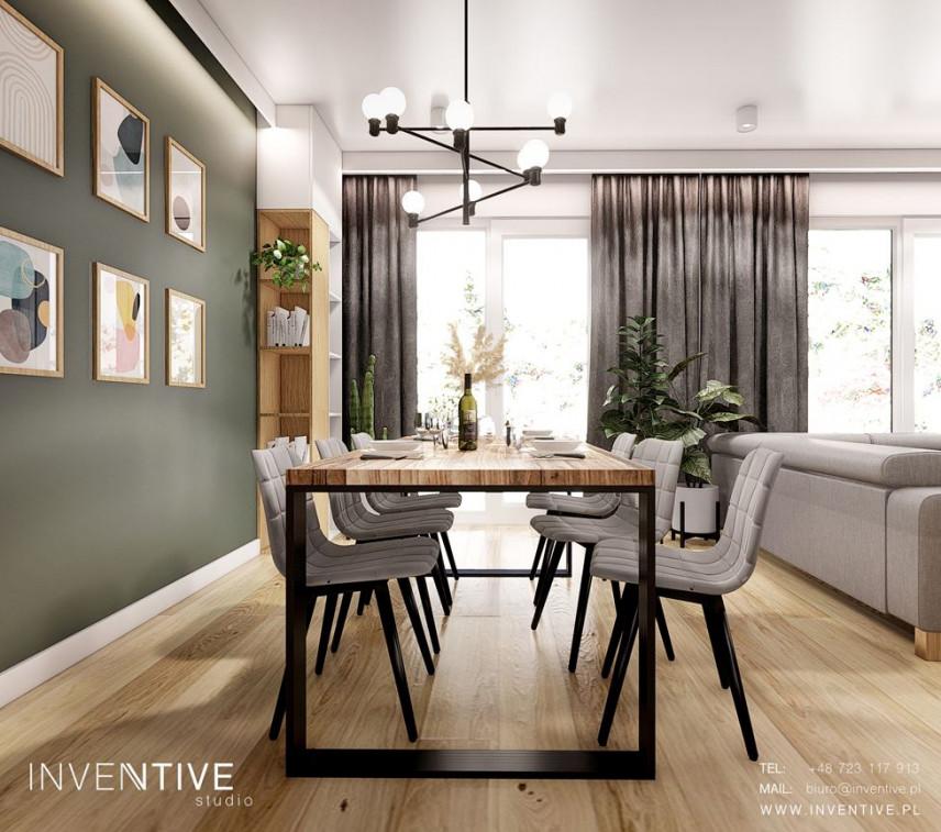 Jadalnia z salonem z butelkową zielenią na ścianie