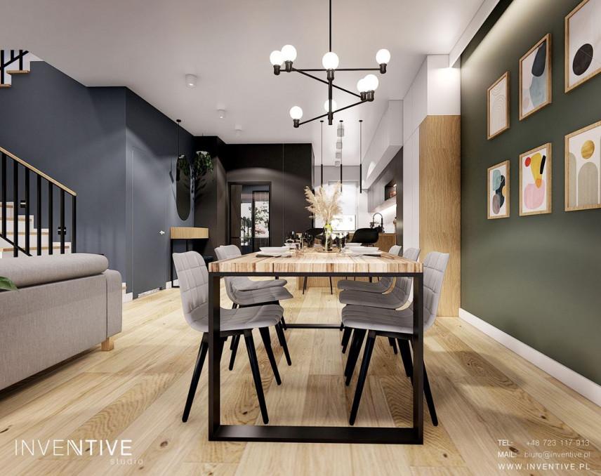 Jadalnia z dużym stołem i tapicerowanymi krzesłami